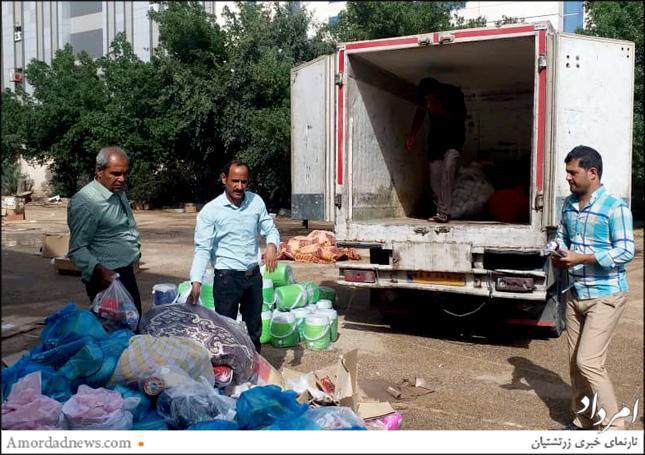 بارندگی شدید در اهواز و استفاده از کامیون سرپوشیده برای جمل کالاهای مورد نیاز سیلزدگان